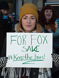 © Licensed to London News Pictures. 02/01/2017. Carmarthen, Carmarthenshire, Wales, UK. Anti-Bloodsport activists gather in the Welsh town of Carmarthen to voice their anger at the continued illegal hunting with dogs - hunting with dogs was made illegal in 2004 by The Hunting Act 2004 (c37). The Anti-Hunt protest takes place on the day that the Carmarthenshire Hunt have chosen to parade through the town to collect money and support for their blood-sports. Photo credit: Graham M. Lawrence/LNP