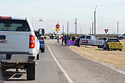 Fans from Ozona line the highway to wish the Iraan High School football team well in the state championship game outside of Ozona, Texas on December 14, 2016. (Cooper Neill for The New York Times)