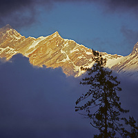 Annapurna Massif, Himalaya, Nepal. Clouds obscure a view of Mount Fang.