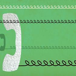 Retro mid century telephones with telephone landline on distressed green background