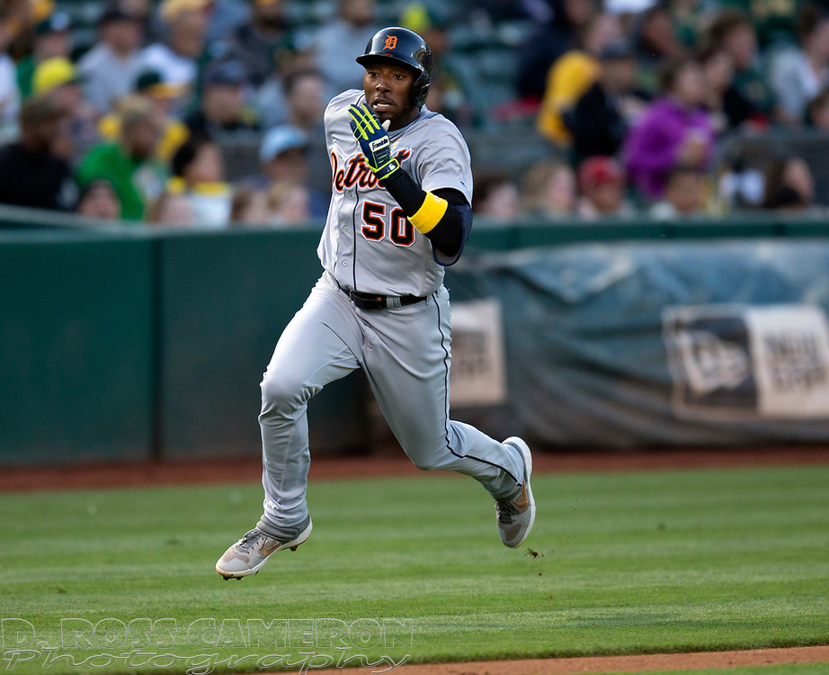 Sep 7, 2019; Oakland, CA, USA; Detroit Tigers Travis Demeritte (50) scores on a two-RBI single by Harold Castro during the second inning of a baseball game against the Oakland Athletics at Oakland Coliseum. Mandatory Credit: D. Ross Cameron-USA TODAY Sports