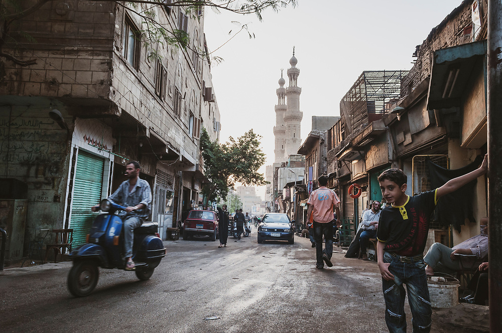 Street scene on El Darb El Gadid, looking toward the historic twin towers of Bab Zuweila, which was built in 1092. Bab Zuweila is the last remaining southern gate from the walls of Fatimid Cairo. <br /> (April 26, 2010)