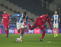 Huddersfield Town's Isaac Mbenza in action with  Birmingham City's Rekeem Harper<br /> <br /> Photographer Mick Walker/CameraSport<br /> <br /> The EFL Sky Bet Championship - Huddersfield Town v Birmingham City - Tuesday 2nd March 2021 - The John Smith's Stadium - Huddersfield<br /> <br /> World Copyright © 2020 CameraSport. All rights reserved. 43 Linden Ave. Countesthorpe. Leicester. England. LE8 5PG - Tel: +44 (0) 116 277 4147 - admin@camerasport.com - www.camerasport.com