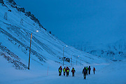 UNIS students walk together down a road in Longyearbyen, Svalbard.
