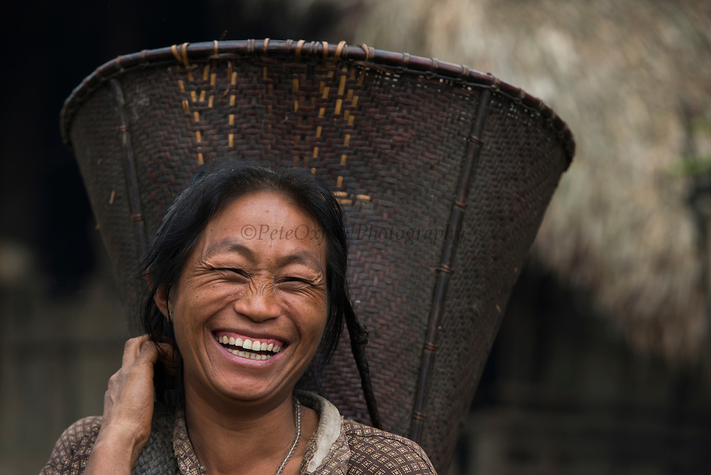 Konyak Naga & rice basket<br /> Konyak Naga headhunting Tribe<br /> Mon district<br /> Nagaland,  ne India