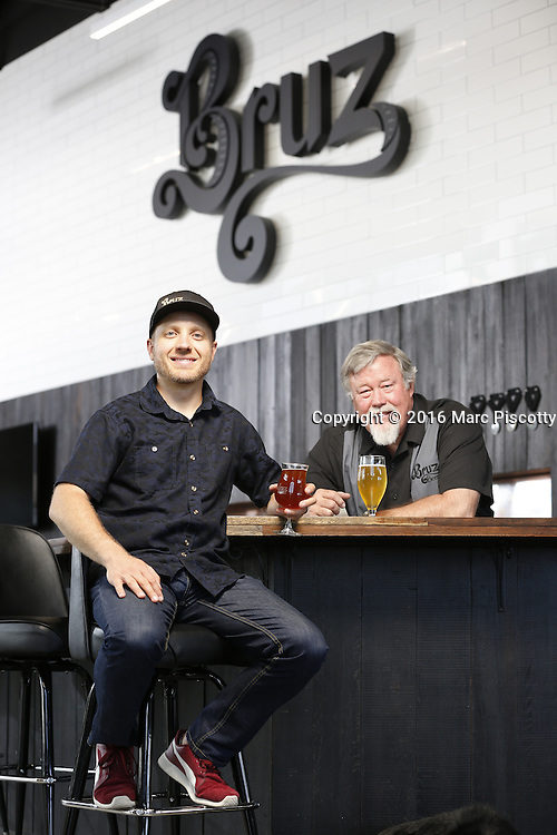 SHOT 7/22/16 1:50:44 PM - Bruz Beers co-founders Charlie Gottenkieny and Ryan Evans inside the new brewery near 67th Avenue and Pecos in Denver, Co. Bruz Beers is Denver's artisanal Belgian-style brewery, featuring a full line of traditional and Belgian-inspired brews, hand-crafted in small batches. Includes images of Evan's dog 'Cooper' as well who serves as the brewery dog. (Photo by Marc Piscotty / © 2016)