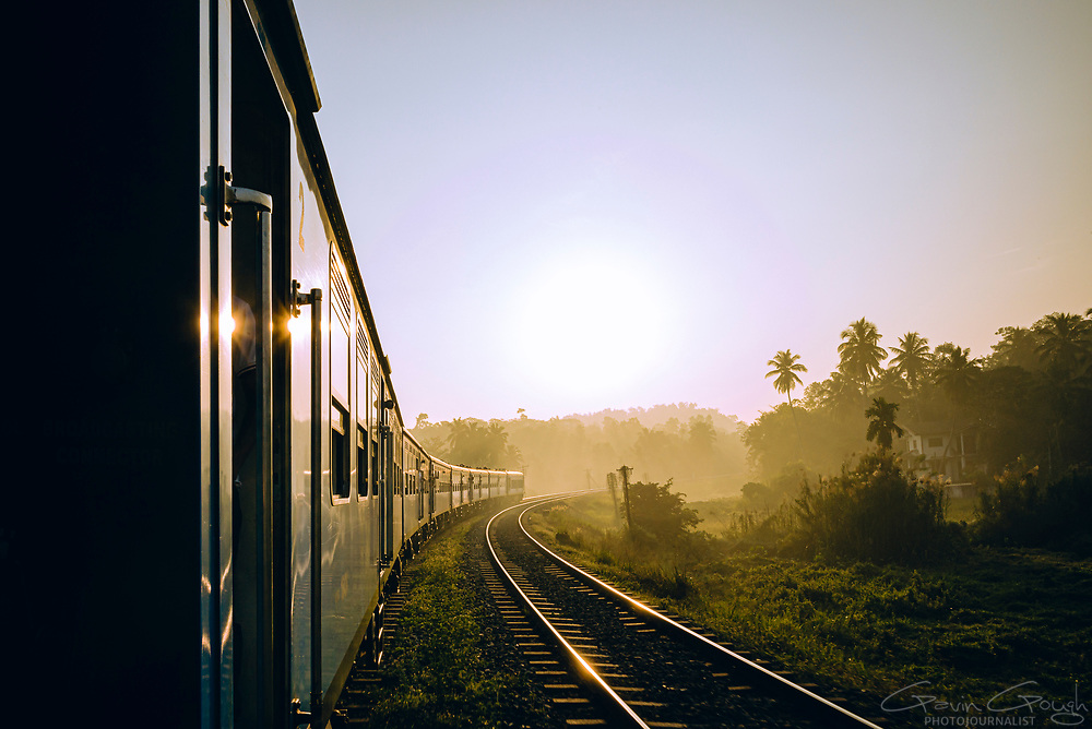 Shortly after sunrise, the sunlight illuminates carriages of the Kandy to Ella train in Sri Lanka, Colombo to Kandy Railway Line, Colombo, Sri Lanka