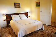 Mas de Perry, Mas Nicot. Terrasses de Larzac. Languedoc. Bed in guest room. France. Europe.