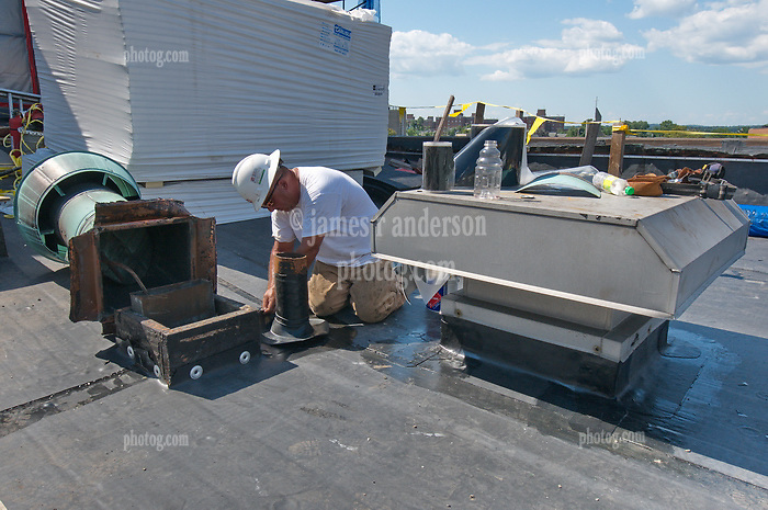 Craftsman at Work repairing Ancient Roof Vent. Bridgeport Courthouse GA 2 Renovations. Replace Roof and Masonry Repairs CT Dept of Public Works Project # BI-JD-305. Third Progress Photography Shoot: 17 August 2011