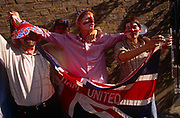 During a street party in London's East End, the young men have decided to parade outside with their flag to show their devotion to their local club. One reaches down to pick up a patriotic hat during the celebrations commemorating the 50th anniversary of VE (Victory in Europe) Day on 6th May 1995. West Ham was founded in 1895 as Thames Ironworks FC and reformed in 1900 as West Ham United. In 1904 the club relocated to their current Boleyn Ground stadium and will take over the 2012 Olympic stadium. In the week near the anniversary date of May 8, 1945, when the World War II Allies formally accepted the unconditional surrender of the armed forces of Germany. Street parties now – as they did in 1945 – played a large part in the country's patriotic well being.