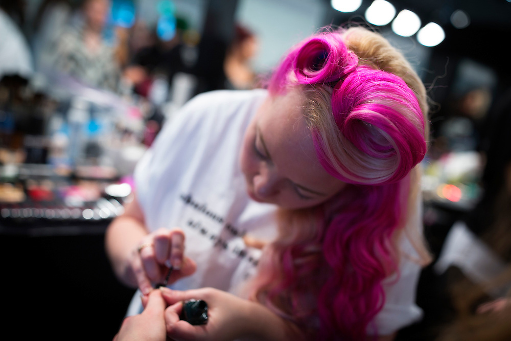 TORONTO, ON - MARCH 15: A stylist paints the nails of a model for the WRKDEPT show during Toronto Fashion Week in Toronto, Ontario. Toronto Star/Todd Korol