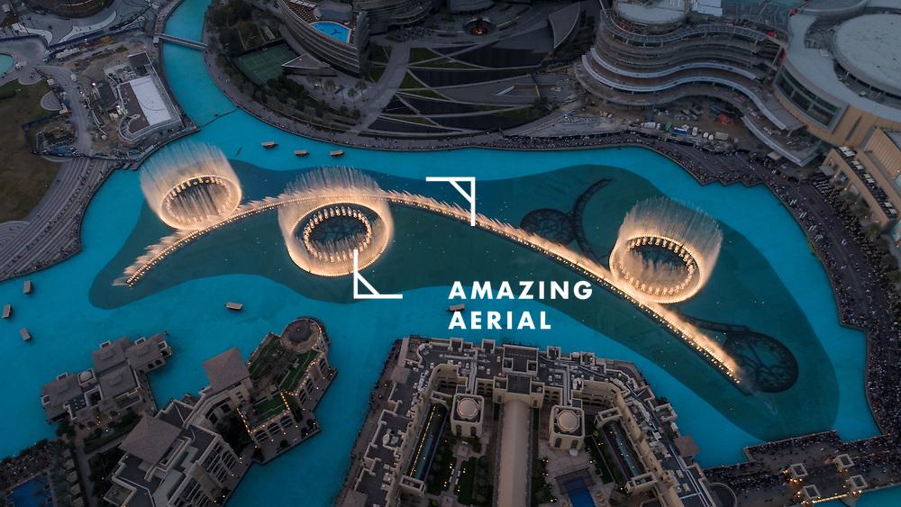 Aerial view of the illuminated Dubai fountain at night in United Arab Emirates.