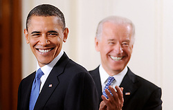 """File photo dated March 23, 2010 of US President Barack Obama and Vice President Joe Biden smile during the signing ceremony of the health insurance reform bill in the East Room in Washington, DC, USA. Former President Barack Obama endorsed Joe Biden, his two-term vice president, on Tuesday morning in the race for the White House. """"Choosing Joe to be my vice president was one of the best decisions I ever made, and he became a close friend. And I believe Joe has all the qualities we need in a president right now,"""" Obama said in a video posted to Twitter. Photo by Olivier Douliery/ABACAPRESS.COM"""