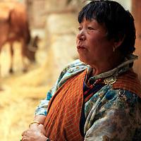 Asia, Bhutan, Paro. Farm wife in Paro Valley of Bhutan.