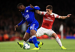 Arsenal's Lucas Torreira and Leicester City's Kelechi Iheanacho (left) battle for the ballb during the Premier League match at the Emirates Stadium, London.