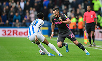 Leeds United's Jack Harrison vies for possession with Huddersfield Town's Demeaco Duhaney<br /> <br /> Photographer Chris Vaughan - CameraSport<br /> <br /> The EFL Sky Bet Championship - Huddersfield Town v Leeds United - Saturday 7th December 2019 - John Smith's Stadium - Huddersfield<br /> <br /> World Copyright © 2019 CameraSport. All rights reserved. 43 Linden Ave. Countesthorpe. Leicester. England. LE8 5PG - Tel: +44 (0) 116 277 4147 - admin@camerasport.com - www.camerasport.com