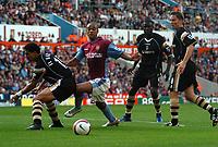 Photo: Ian Hebden.<br />Aston Villa v Charlton Athletic. The Barclays Premiership. 23/09/2006.<br />Villa's Luke Moore (C) evades Talal El Karkouri (L) in the penalty area.