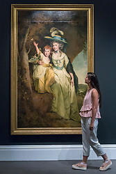 "© Licensed to London News Pictures. 29/06/2018. LONDON, UK. A staff member views ""Portrait of Susannah Arkwright, Mrs Charles Hurt and her daughter Mary Anne"" by Joseph Wright of Derby (Est. £1.5-2m).  Preview of Old Masters, British, Treasures, Sculptures and Ancient works at Sotheby's New Bond Street to be offered for sale on 3 and 4 July 2018.  Photo credit: Stephen Chung/LNP"