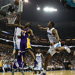 April 24, 2011; New Orleans, LA, USA; New Orleans Hornets center Emeka Okafor (50) blocks a shot by Los Angeles Lakers shooting guard Kobe Bryant (24) during the second quarter in game four of the first round of the 2011 NBA playoffs at the New Orleans Arena.    Mandatory Credit: Derick E. Hingle