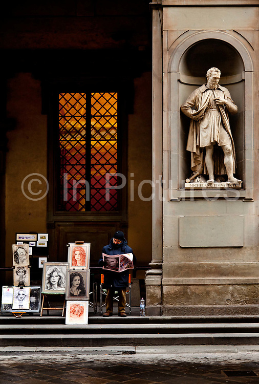 Portrait painter outside the Uffizi gallery. The Uffizi Gallery is a museum in Florence, Italy. It is one of the oldest and most famous art museums of the Western world. The narrow courtyard between the Uffizi's two wings creates the effect of a short, idealized street;