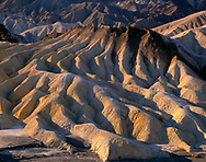 CADDV_013 - Eroded mudstone forms patterns of hills and valleys, early morning view south from Zabriskie Point, Death Valley National Park, California, USA