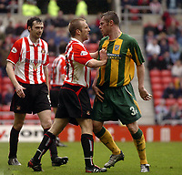 Photo. Glyn Thomas.<br /> Sunderland v West Bromwich Albion. <br /> Nationwide Division 1. 18/04/2004.<br /> Tempers flare as Sunderland's Darren Williams (C) gets to grips with Geoff Horsfield (R).