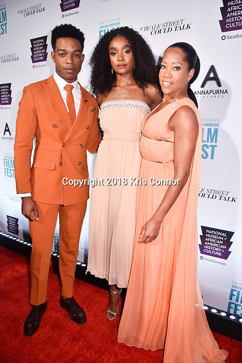 """WASHINGTON, DC - OCTOBER 27: Actors Regina Hall, Stephan James, and KiKi Layne attend  the closing night screening of """"IF BEALE STREET COULD TALK"""" at the inaugural Smithsonian African American Film Festival 2018 at National Air and Space Museum in Washington DC on October 27th, 2018. (Photo by Kris Connor/Annapurna Pictures)"""