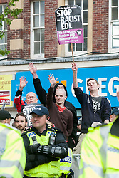 UAF members and supporters chant at the EDL Rally in All Saints Square near Rotherham Minster during Saturdays  EDL rally in South Yorkshire  in Rotherham Town Centre <br /> <br /> May 10 2014<br /> Image © Paul David Drabble <br /> www.pauldaviddrabble.co.uk