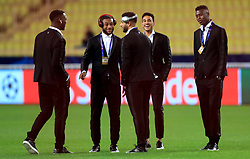 AS Monaco's Moussa Sylla (second left), Jordi Mboula (second right) and Loic Badiashile (right) talk to their team mates on the pitch prior to the match kick off