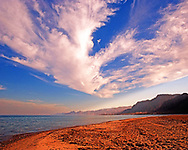 The desert beach on the edge of the Sinai where it meets the Red Sea is one of the most stunning natural landscapes I have ever visited. In this photograph I have captured the powerful blue sky with massive white clouds against the emptiness of the rocky desert coastline bellow. We can pick up a hint of pinkish red in this powerful blue sky against the empty sands and rocks on this baron desert coast line. <br /> <br /> This image is ready to download for personal or commercial use and to order as a limited edition print. I will only make available 50 prints of this image, you can choose to have it printed on canvas or as a framed or unframed print ensuring you have an exclusive peace of highly collectable photo art to add to any home or business.
