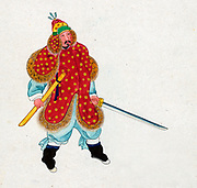 Member of the Korean Royal Guard in traditional dress.  Coat and helment lined with hard leather and studded with iron buttons. Watercolour c1890 of soldier carrying sword, full-length facing right.
