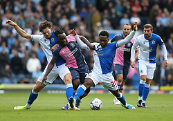 Coventry City's Fankaty Dabo (centre) battles with Blackburn Rovers' Sam Gallagher (left) and Tayo Edun (right) during the Sky Bet Championship match at Ewood Park, Blackburn. Picture date: Saturday October 16, 2021.