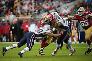 The New England Patriots tackle San Francisco 49ers running back Carlos Hyde (28) during a carry at Levi's Stadium in Santa Clara, Calif., on November 20, 2016. (Stan Olszewski/Special to S.F. Examiner)