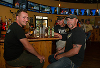 Edward Stettmeier of Milton, NH sits at the bar with Larry Sharpe and Richard Patterson from Woodstock New Brunswick Canada at the Whiskey Barrel in downtown Laconia Tuesday evening.  (Karen Bobotas/for the Laconia Daily Sun)