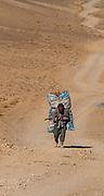 Man carrying a huge pile, Bamyan, Afghanistan