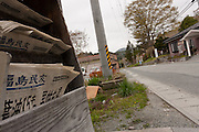 Newspapers dated from March 14th remain in racks outside a local store in the abandoned village of Tsushima in rural Fukushima near the exclusion zone, Fukushima Japan. Wednesday May 5th 2011. A 20 kilometre exclusion zone was set up on April 22nd to limit exposure to radiation from the Fukushima Daichi nuclear power station that was damaged in the earthquake and tsunami of March 11th 2011