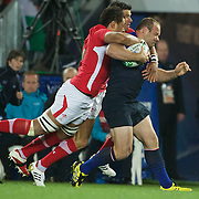 William Servat, France, is tackled by Toby Faletau, (left) and Mike Phillips, Wales, during the Wales V France Semi Final match at the IRB Rugby World Cup tournament, Eden Park, Auckland, New Zealand, 15th October 2011. Photo Tim Clayton...