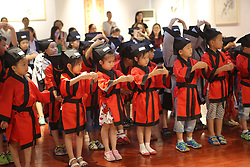 July 3, 2017 - Binzhou, Binzhou, China - Binzhou, CHINA-July 3 2017: (EDITORIAL USE ONLY. CHINA OUT)...Children in Han costumes attend the first writing ceremony in Binzhou, east China's Shandong Province, July 3rd, 2017.The First Writing Ceremony, also called Qi Meng (Enlightenment) Ceremony, was an important ceremony for every student before they were admitted to school in ancient China. (Credit Image: © SIPA Asia via ZUMA Wire)