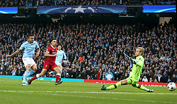 Manchester City's Gabriel Jesus (left) scores his side's first goal of the game