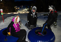 Aubrey and Dylan hop into their tubes for a tandem start with Cameron Haradon during the Boys and Girls Club Tubing Party at Gunstock Sunday evening.  (Karen Bobotas/for the Laconia Daily Sun)