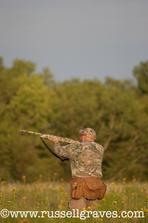DOVE HUNTER SHOOTING TO BIRDS