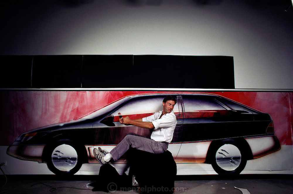 Art Center College of Design, Pasadena, California. Department of Transportation Design. Mark Gorman pretends to drive one of his car designs in 1983. MODEL RELEASED. USA.
