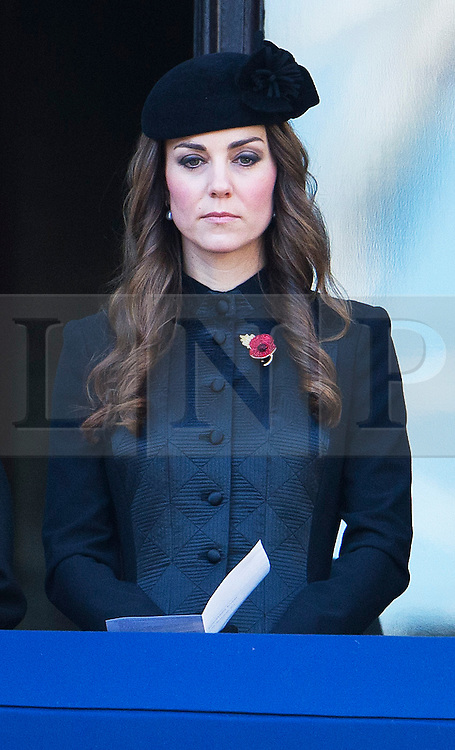 © London News Pictures. 10/11/2013. London, UK. Catherine Duchess of Cambridge looking over during the Remembrance Day Ceremony at the Cenotaph war memorial in London, United Kingdom, on November 10, 2013 . Royalty and Politicians joined the rest of the county in honouring the war dead by gathering at the iconic memorial to lay wreaths and observe two minutes silence. Photo Credit: Ben Cawthra/LNP