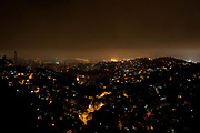 View of Rio Comprido at night from Santa Teresa with streetlights and mist, Rio de Janeiro, Brazil