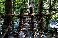 The Iya No Kazurabashi, a rather daunting tree vine suspension bridge overthe Iya River. This ancient vine bridge is suspended between a valley, surrounded on both sides of by ancient forest, slowly swaying in the breeze.  Actinidia arguta vines are harvested from the mountains during the harsh winter, are woven together to form the vine bridges, and have to be rebuilt evey few years.. These became extremely important lifelines for people in the region, and were common along the Iya Valley at one time.