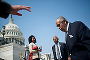 Rep. CHARLIE RANGLE (D-NY) makes his way up the steps of the Capitol following a rally of House Democrates In support of President Obama's Jobs bill.