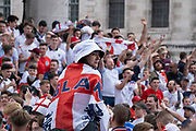 Hours before the England football team play an historic game against Italy the first time since 1966 that the English national team have played in a major mens international football final, thousands of mainly young male supporters crowd without face coverings nor social distancing in Trafalgar Square, on 11th July 2021, in London, England.