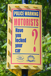 Police sign warning motorists to lock their cars,