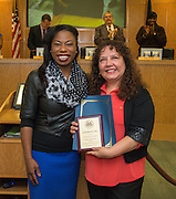 Tracie Hart Jackson, left, presents Elizabeth Luna with the Employee of the Month Award during the Houston ISD Board of Trustees meeting, February 11, 2016.
