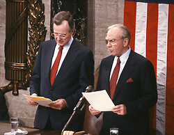 United States Vice President George H.W. Bush, left, and Speaker of the United States House of Representatives Jim Wright (Democrat of Texas), right, on the rostrum as they await the arrival of U.S. President Ronald Reagan to deliver his State of the Union Address in the U.S. Capitol in Washington, D.C. on January 25, 1988.<br /> Credit: Ron Sachs / CNP /ABACAPRESS.COM